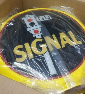 Photo of a Signal gas pump globe wrapped in plastic in a shipping box.