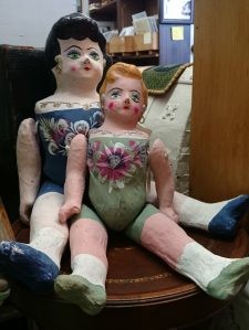 Photo of two creepy dolls.