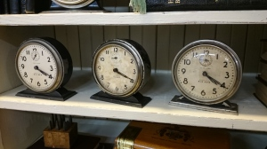 Photo of three vintage clocks sitting side by side.