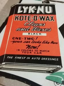 Close up photo of a vintage Lyk-Nu Kote-O-Wax countertop display advertisement.