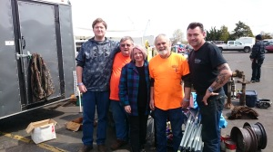 Photo of Karen and Mark with the guys who are their booth neighbors at the swap meet.