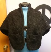 Photo of a vintage black karakul sheep wrap on a dress form.