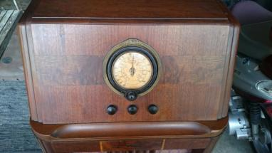 Photo showing a closeup of the face of a 1938 Philco floor radio, model number 38-7.