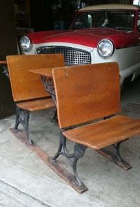 Photo of set of two antique school desks.